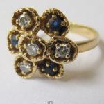 750 Gelbgold Ring Blütenform Diamanten blaue Edelsteinen